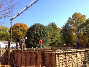 Foundation workers pour concrete