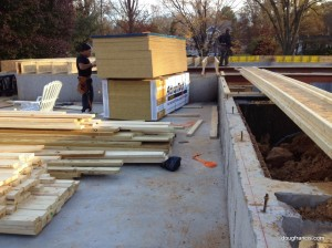 Carpenters prepare joists and decking