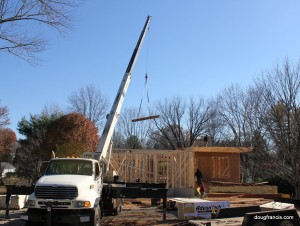 Crane lift i-beam on custom home construction